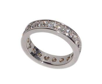 Compro Aliança em ouro 18K cravejada de diamantes